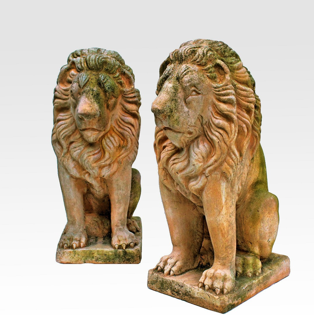 PAIR OF EARTHENWARE LIONS