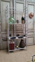 Shelf display stand of vintage, aluminum bakery;