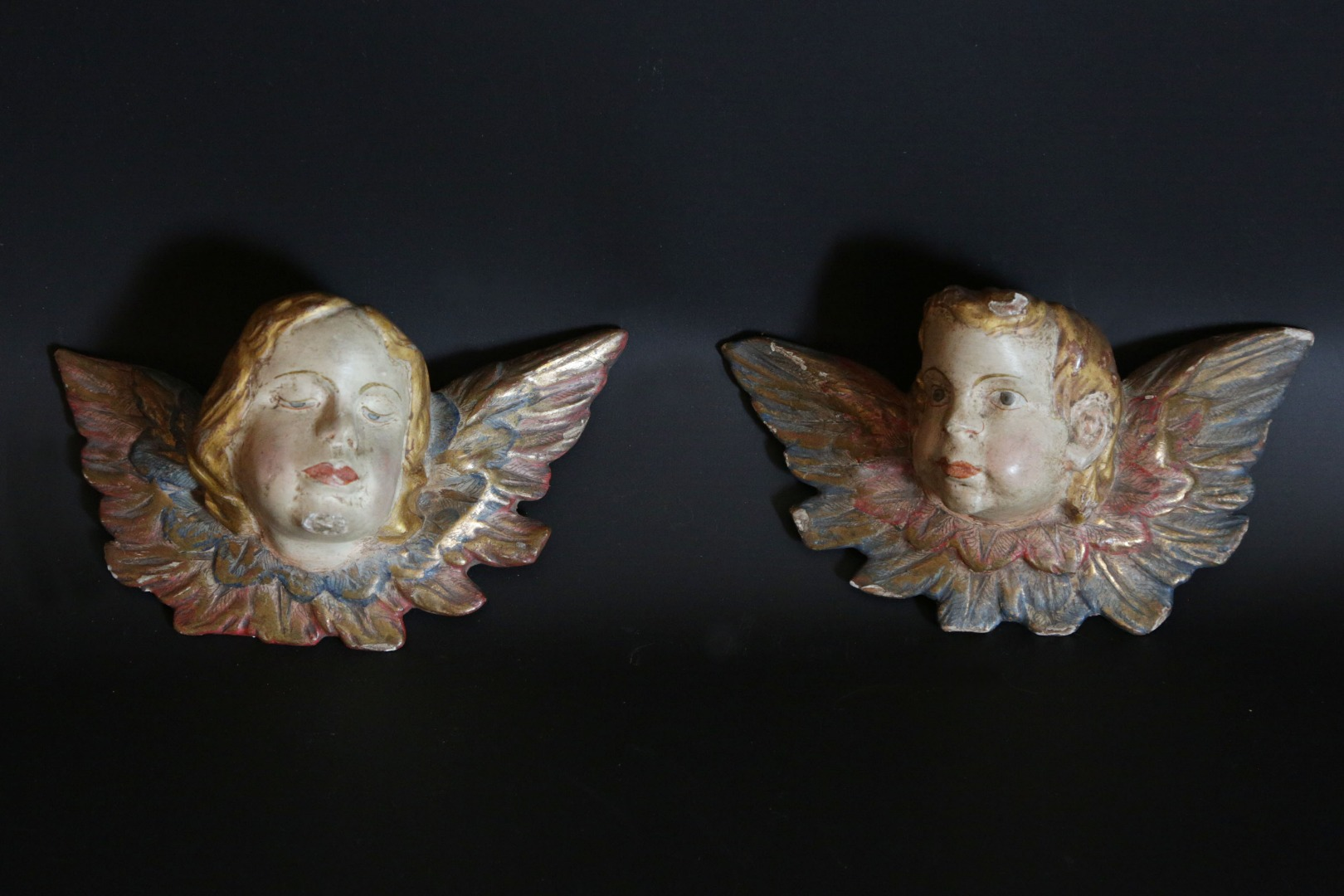 Pair of angels in painted wood  End of the 17th century beginning of the 18th century