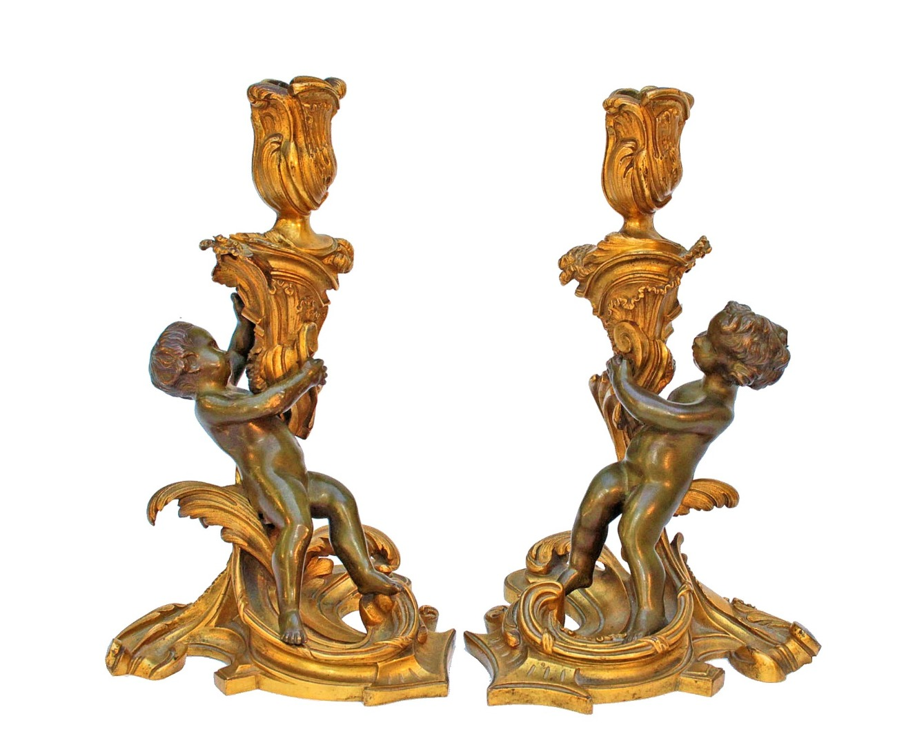 PAIR OF GILT CANDLESTICKS after Juste Aurèle Meissonnier (1695-1750)