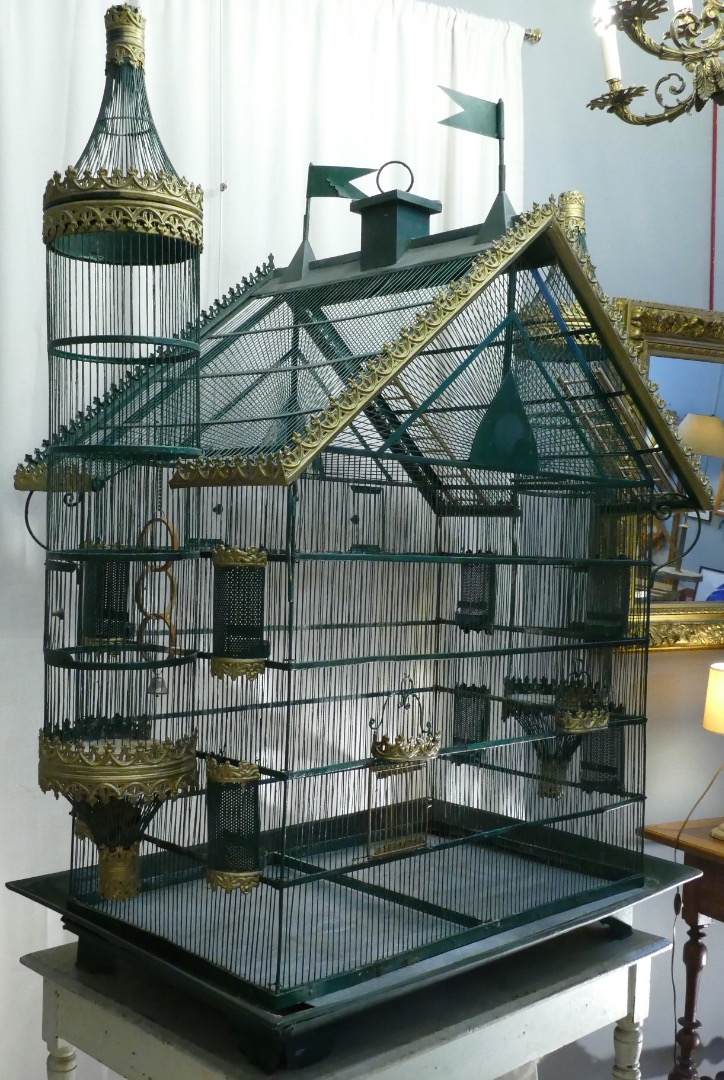 19th century iron and zinc birdcage resting on a zinc base