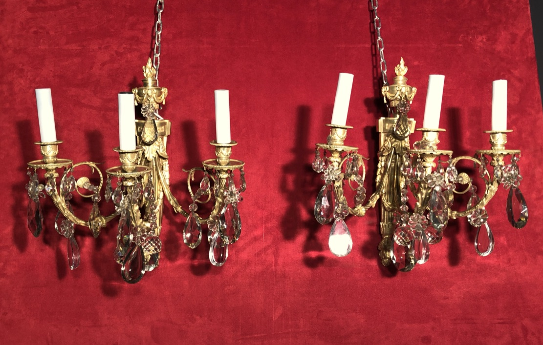 GILT BRONZE AND CRYSTAL WALL LIGHTS