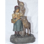 EARTHENWARE FIGURE OF LITTLE RED RIDING HOOD