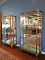 Pair of display cabinet with curved side in bronze and gold brass. Early twentieth century.